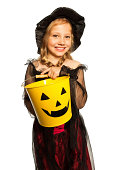 istock In witch costume holding Halloween bucket 513254843