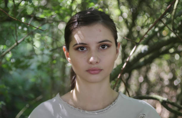 in woodland shade young beautiful bulgarian outdoor girl - whiteway bulgarian outdoor girl stock photos and pictures