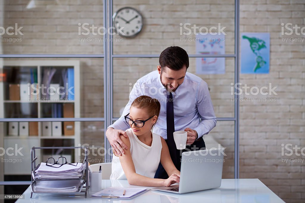 Inappropriate office behavior stock photo