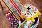 Inca woman weaving alpaca wool
