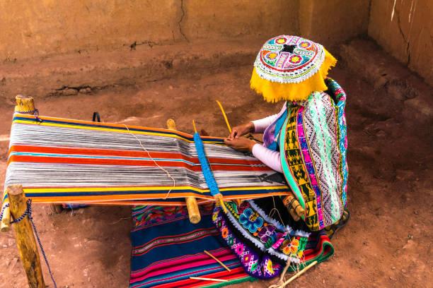 Inca woman weaving alpaca wool Inca woman weaving alpaca wool craft product stock pictures, royalty-free photos & images