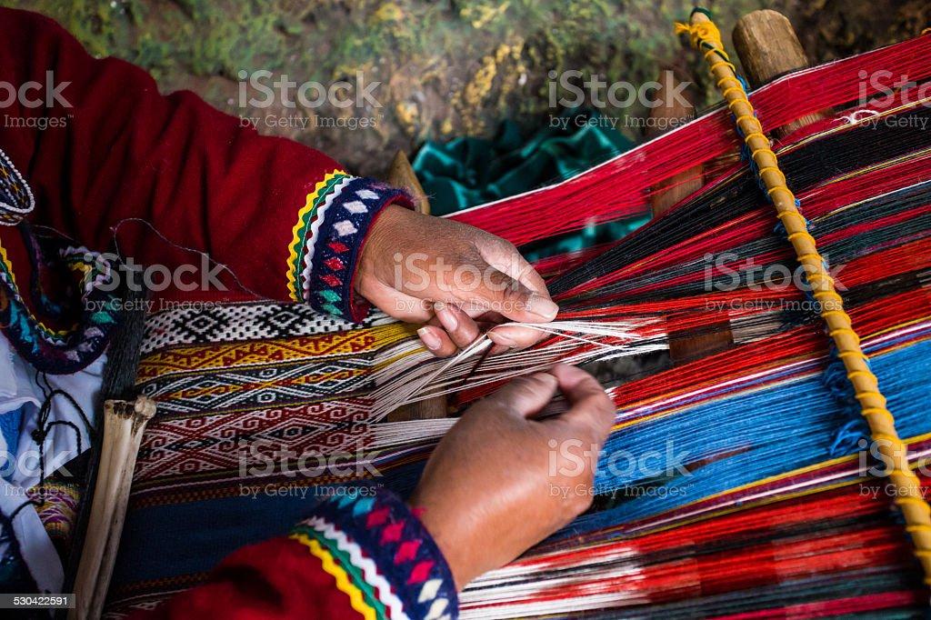 Inca woman weaving alpaca wool stock photo