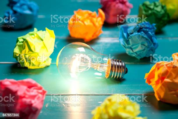 Incandescent bulb and colorful notes on turquoise wooden table picture id647657344?b=1&k=6&m=647657344&s=612x612&h=1d3ftzvly53rjmuyinvoceegno50dadqknhkl458oqy=
