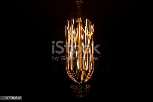 Incandescent light bulb wire glowing in the dark