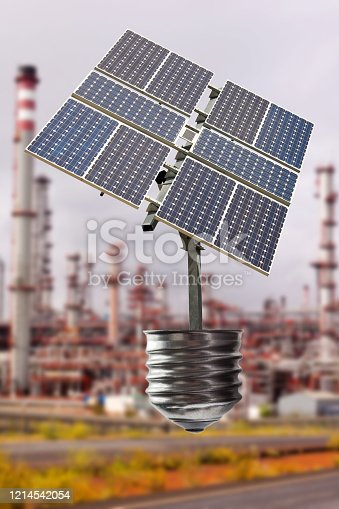 Incandescent light bulb with a Solar Panel in a Big Refinery