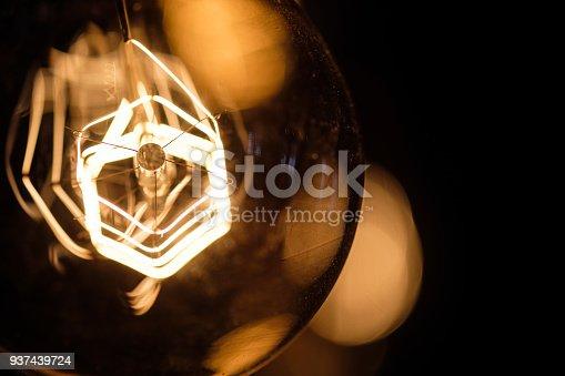 940992564 istock photo Incandescent spiral retro vintage warm lamp edison 937439724