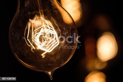 940992564 istock photo Incandescent spiral retro vintage warm lamp edison 937439784