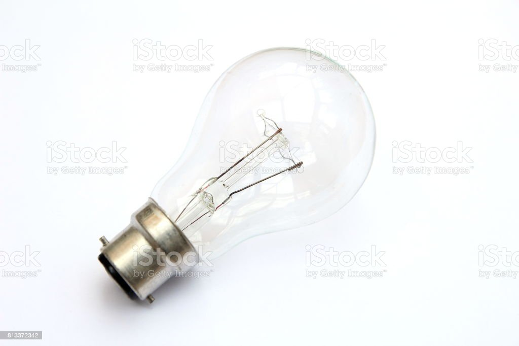 Incandescent tungsten clear B22 bayonet fitting light bulb isolated on white stock photo