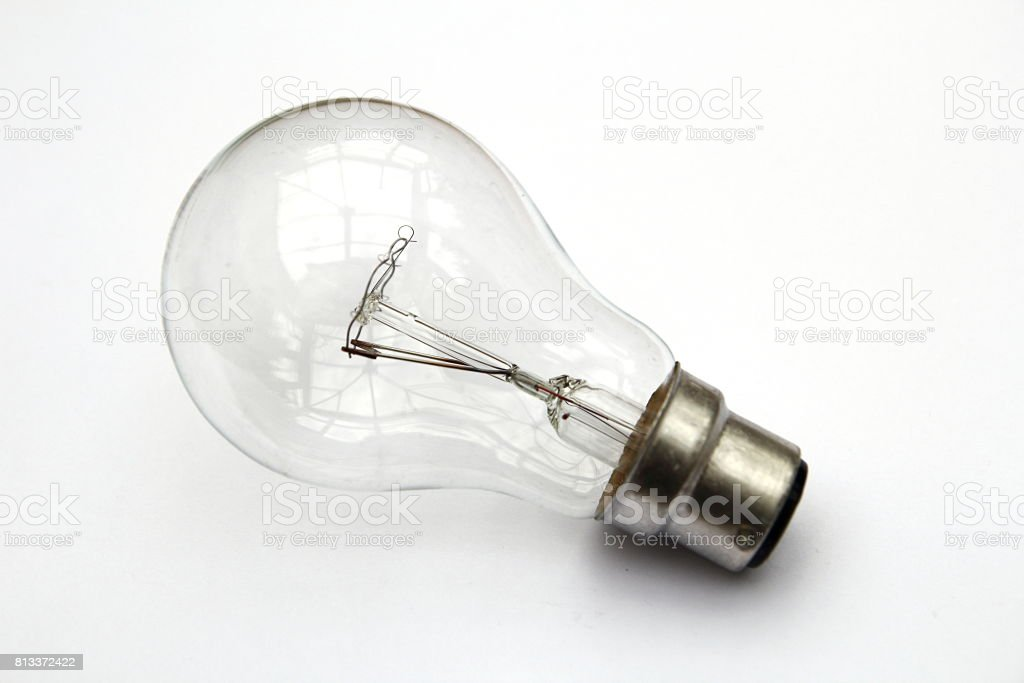 Incandescent tungsten clear light bulb isolated on white stock photo