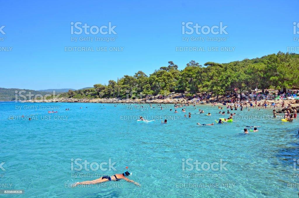 Incekum Beach, Marmaris, Turkey - July 24, 2017- People are swimming in a turquoise sea. stock photo