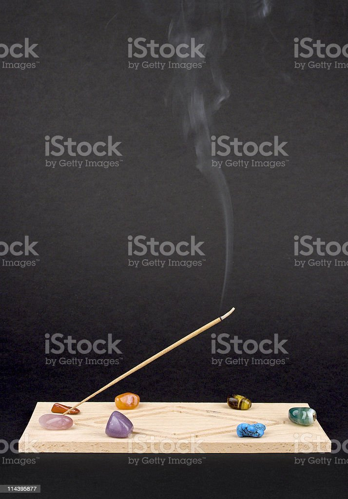 Incence Holder With Smoke And Crystals royalty-free stock photo
