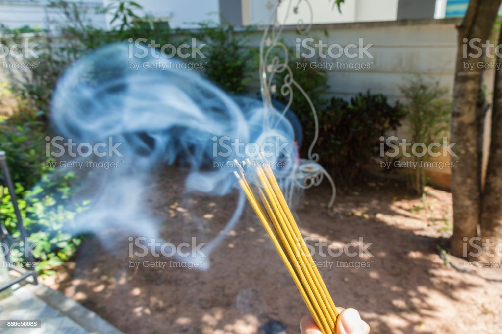 incense burn with smock with food for worship stock photo