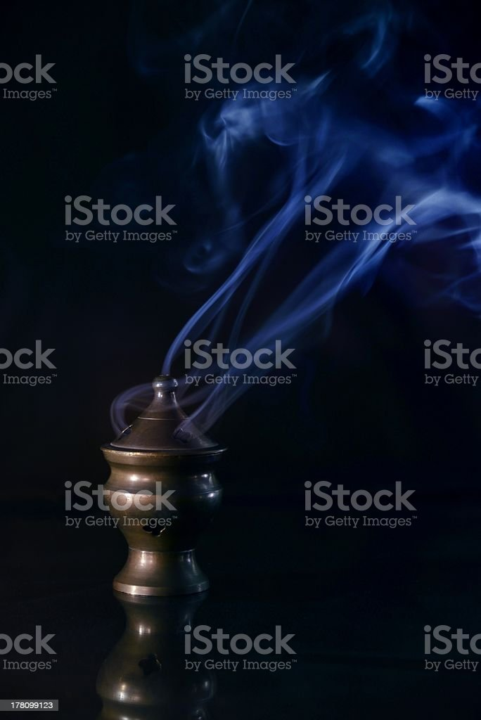 Incense Burner with blue Smoke stock photo