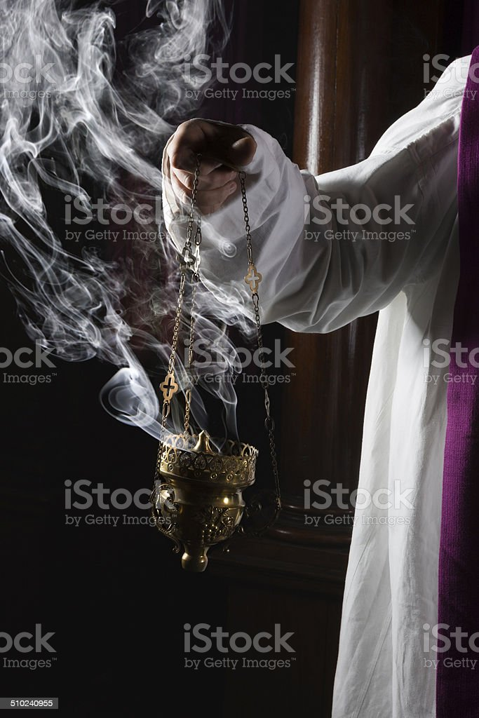Incense burning in church stock photo