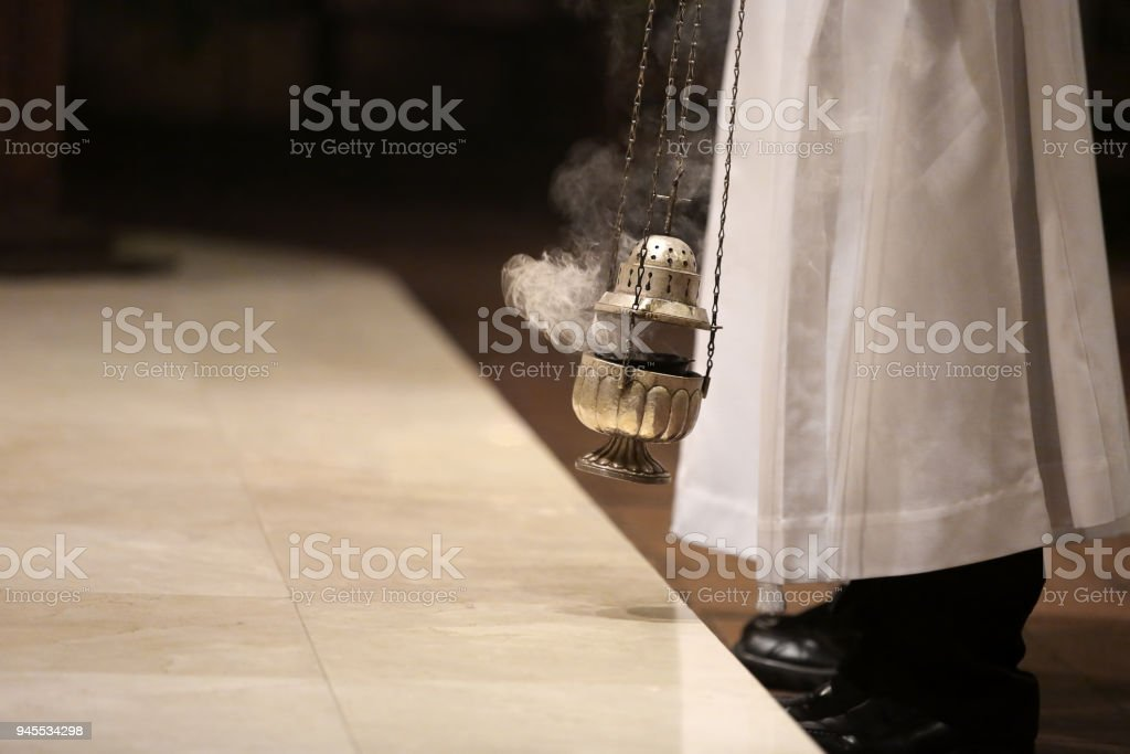 Incense during Mass at the altar and empty space for text stock photo