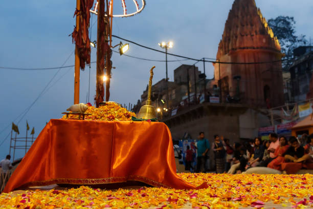 Incense, flowers, candles and other things for Ganga aarti ceremony rituals in Dashashwamedh Ghat. Varanasi. India Varanasi, India - March 15, 2019: Incense, flowers, candles and other things for Ganga aarti ceremony rituals at Dashashwamedh Ghat dashashwamedh ghat stock pictures, royalty-free photos & images