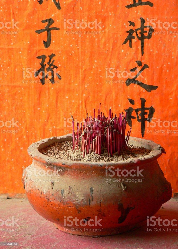 Incense holder with orange background & chinese writing Hong Kong royalty-free stock photo