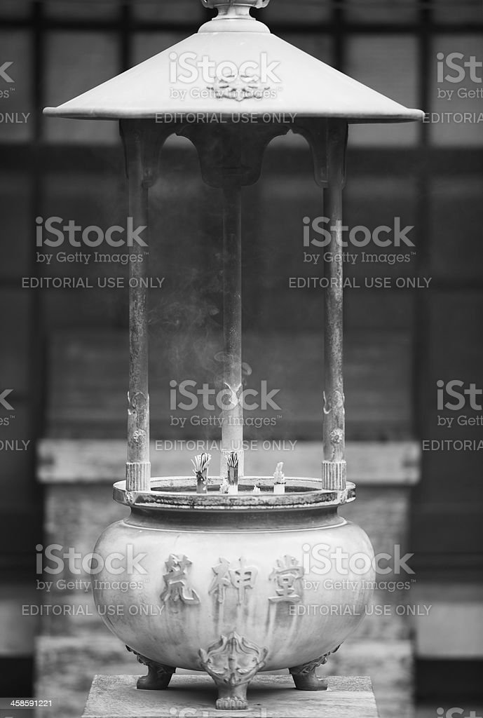 Incense is burning at Buddhist temple in Tokyo royalty-free stock photo