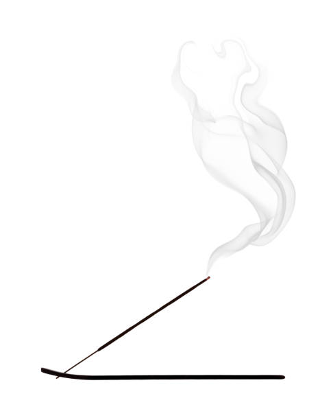 Incense, silhouette with smoke on white background stock photo