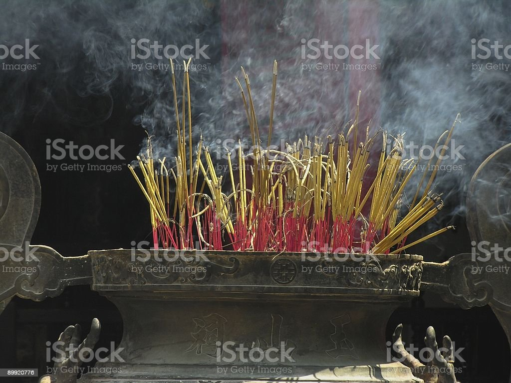 Incense sticks burning in Buddhist temple stock photo