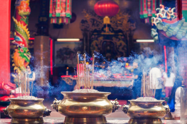 Incense sticks in the pot inside Guan Di Buddhist Temple. Kuan Ti Temple in Chinatown. Kuala Lumpur. Malaysia Incense sticks in the pot inside Guan Di Buddhist Temple. Kuan Ti Temple in Chinatown. Kuala Lumpur. taoism stock pictures, royalty-free photos & images