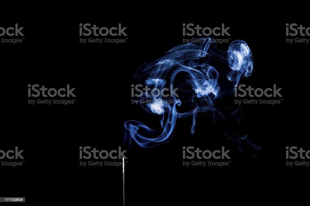 Incense with Smoke Swirling royalty-free stock photo
