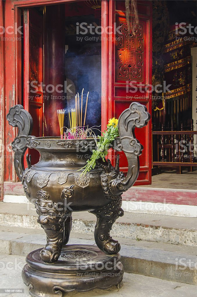 Incenses burning in front of Buddhist temple royalty-free stock photo