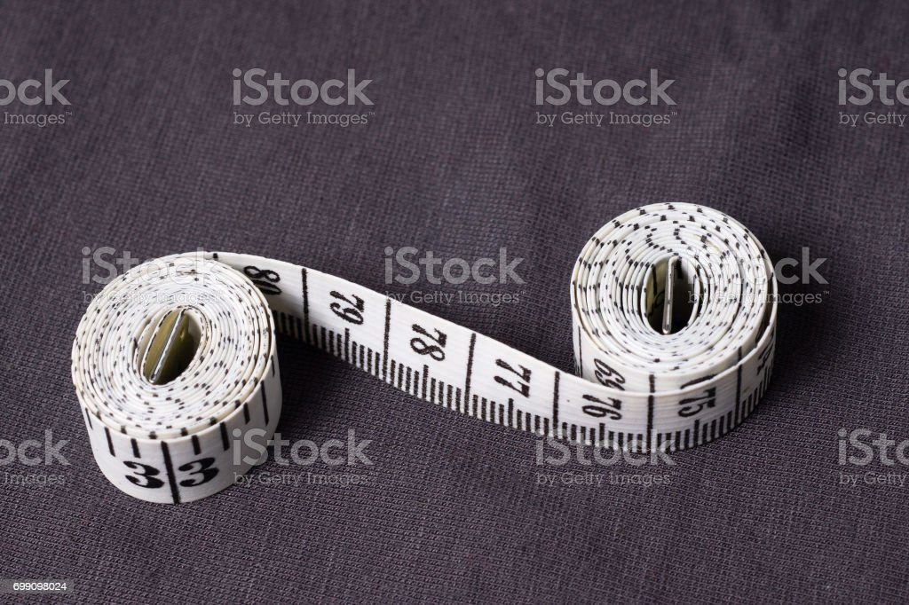 Inch, centimeter tape tailor folded in the form of eight stock photo