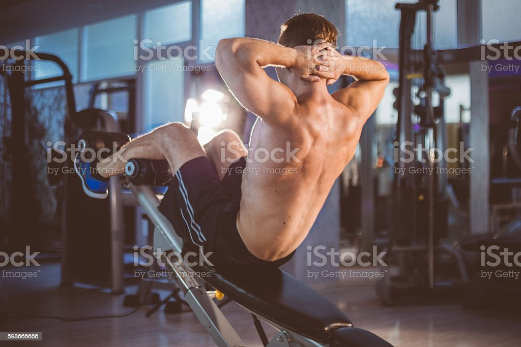 Incline sit-up training stock photo