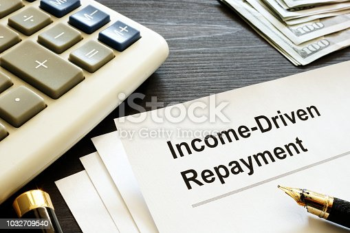 Income Driven Repayment. Papers, calculator and money.