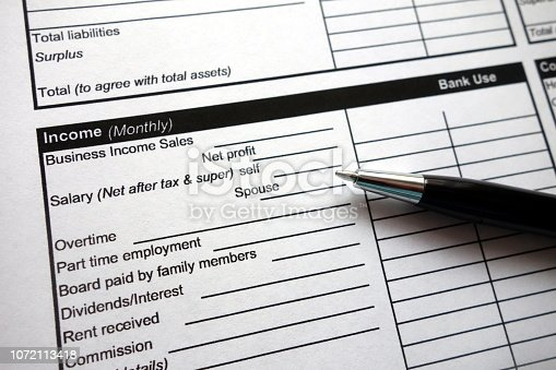 1024130248 istock photo Income heading on credit application form with pen 1072113418