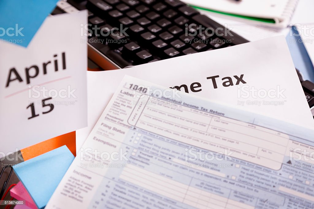 USA income tax deadline is April 15. 1040 form. Desk. stock photo