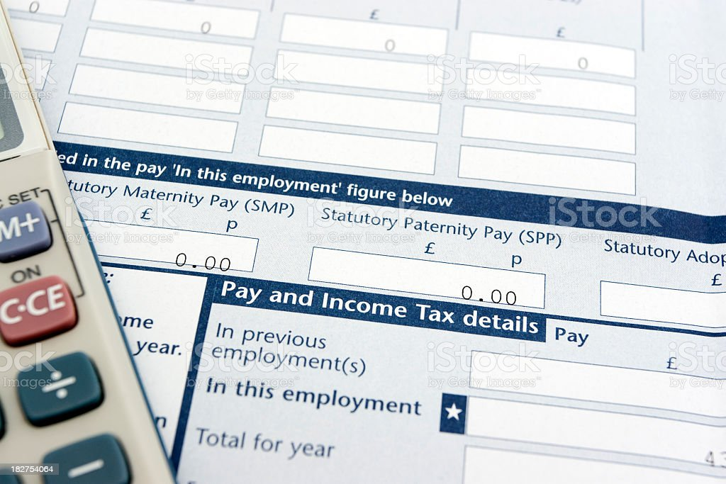 UK income tax form and calculator royalty-free stock photo