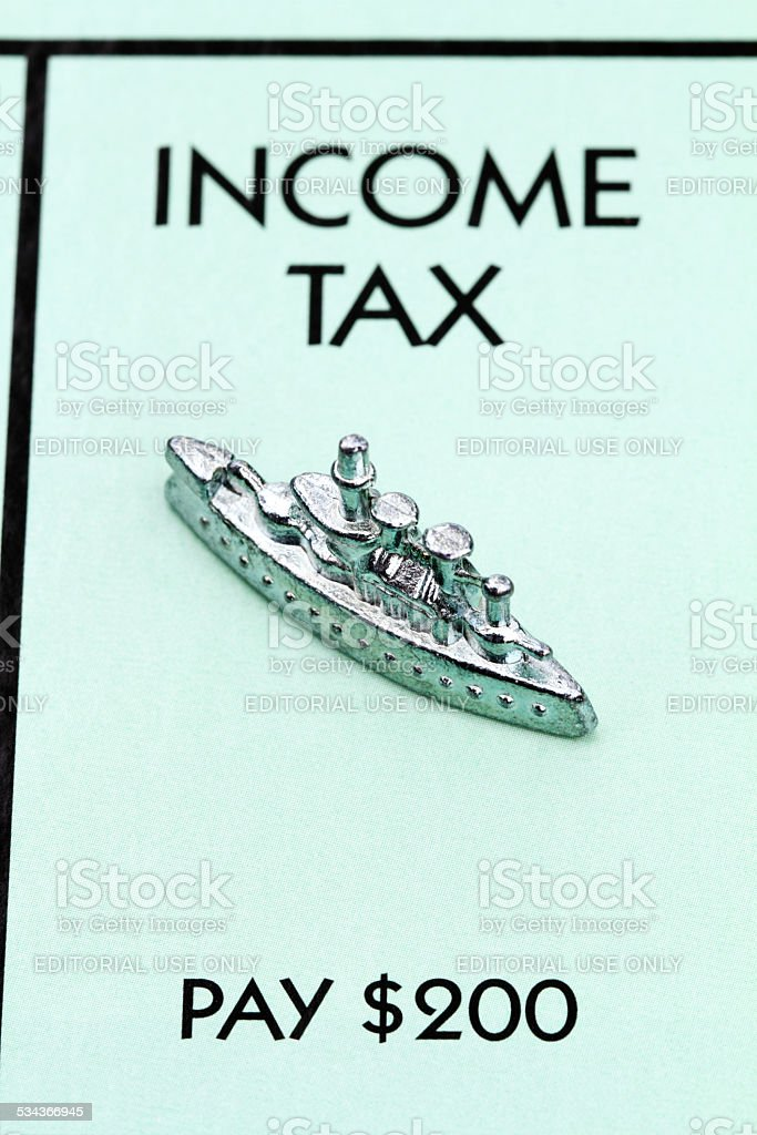 Income Tax on Monopoly game board stock photo
