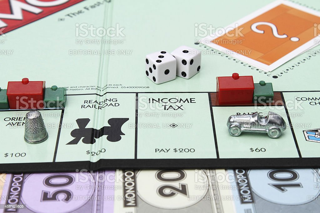 Income tax space on Monopoly board game stock photo