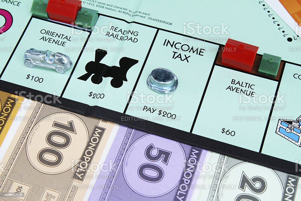 Income tax square on Monopoly board game stock photo