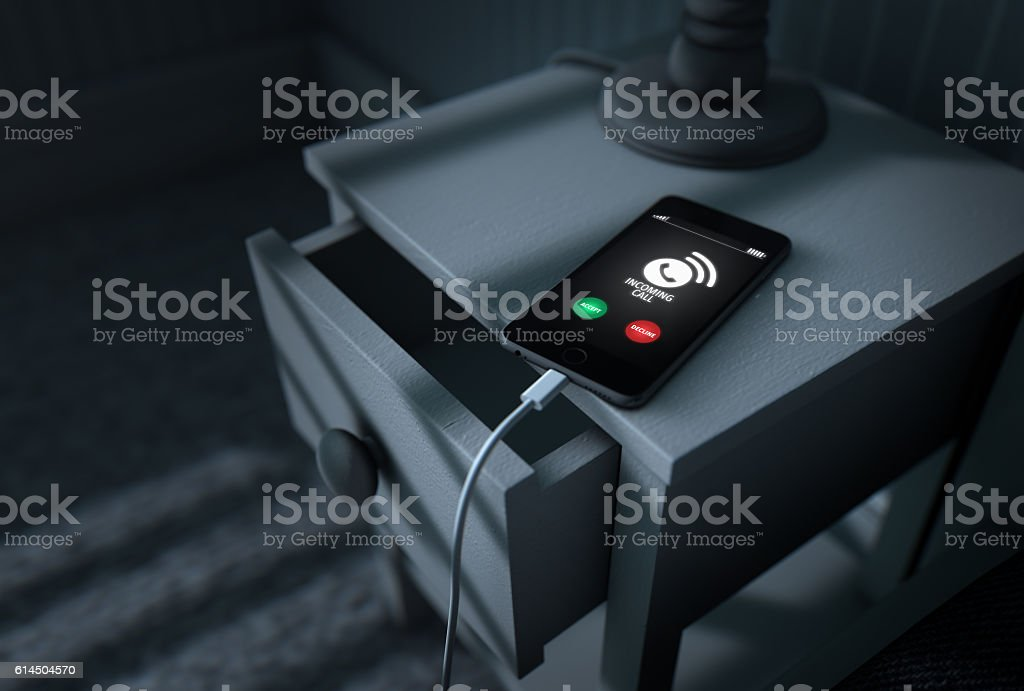 Incoming Call Cellphone Next To Bed - foto de stock