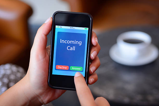Incoming call on smart phone stock photo