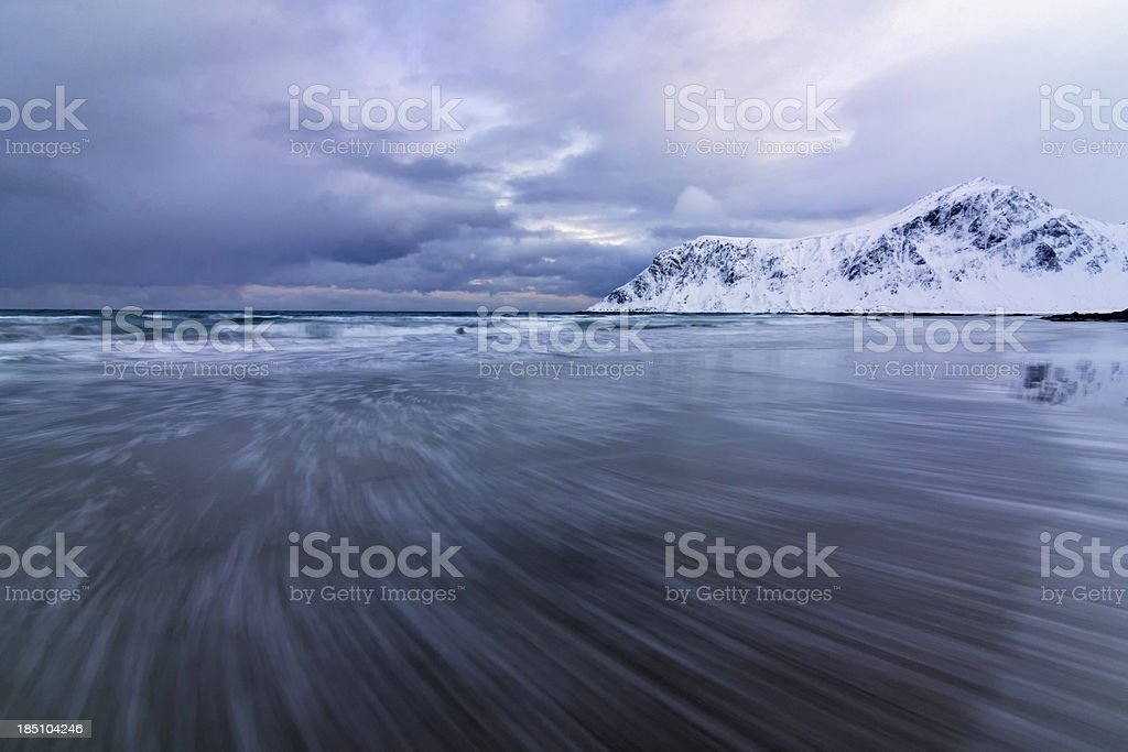 Incoming Wave on Beach with Mountain royalty-free stock photo