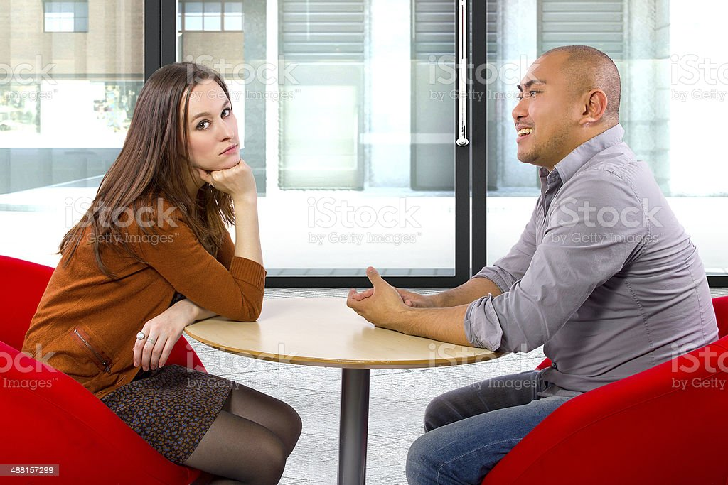 Incompatible Couple on a Boring Date in a Restaurant stock photo
