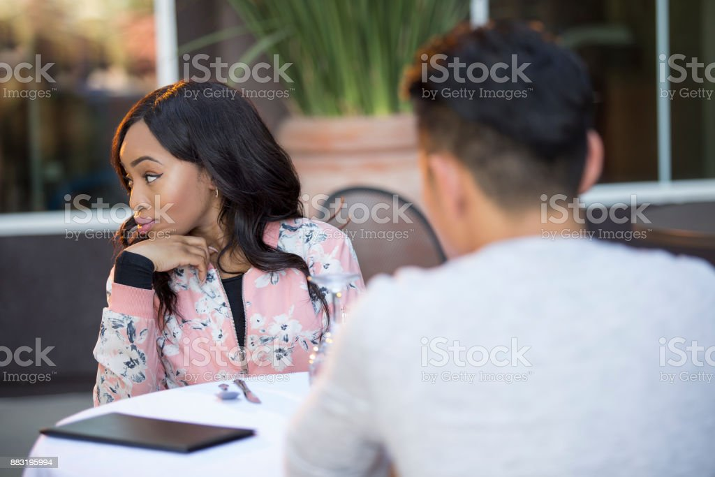 Incompatible Interracial Couple on a Blind Date or Speed Dating stock photo