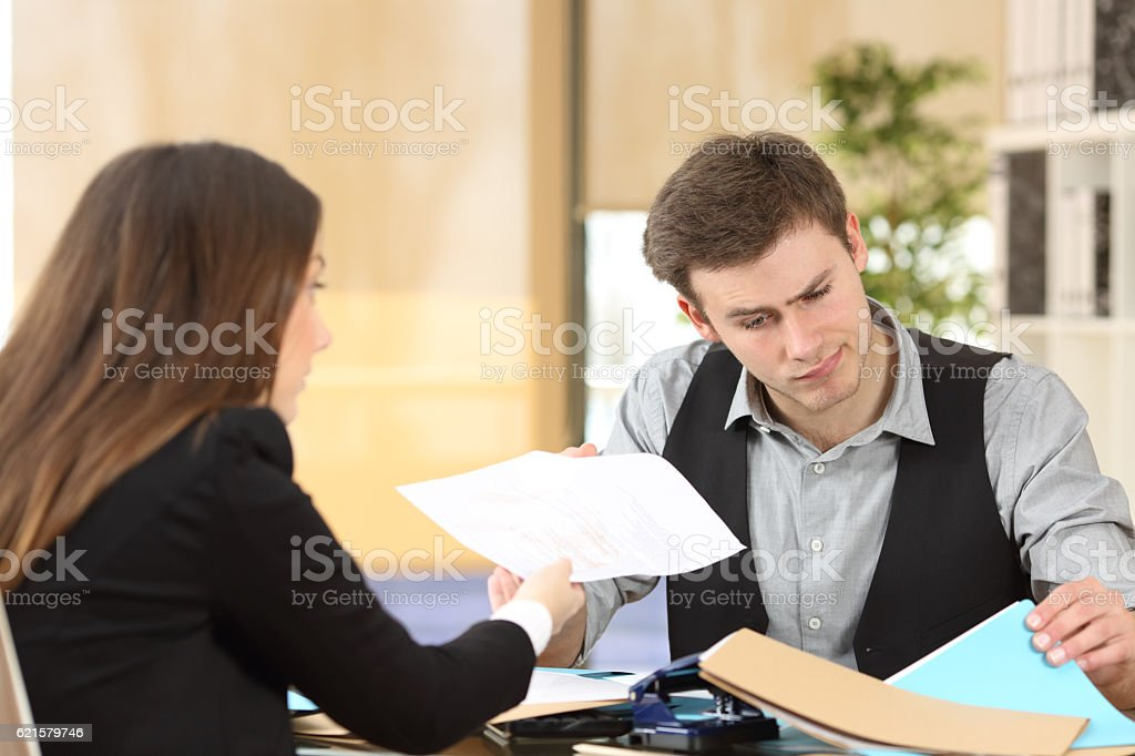 Incompetent businessman attending a client stock photo