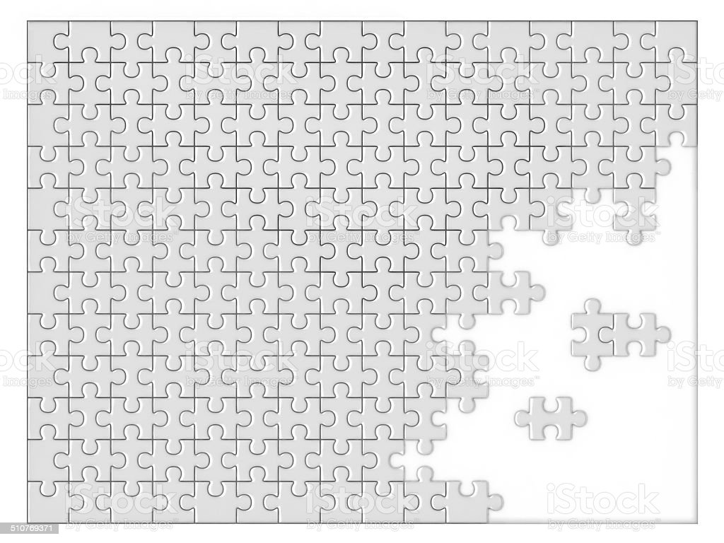 incomplete blank jigsaw stock photo