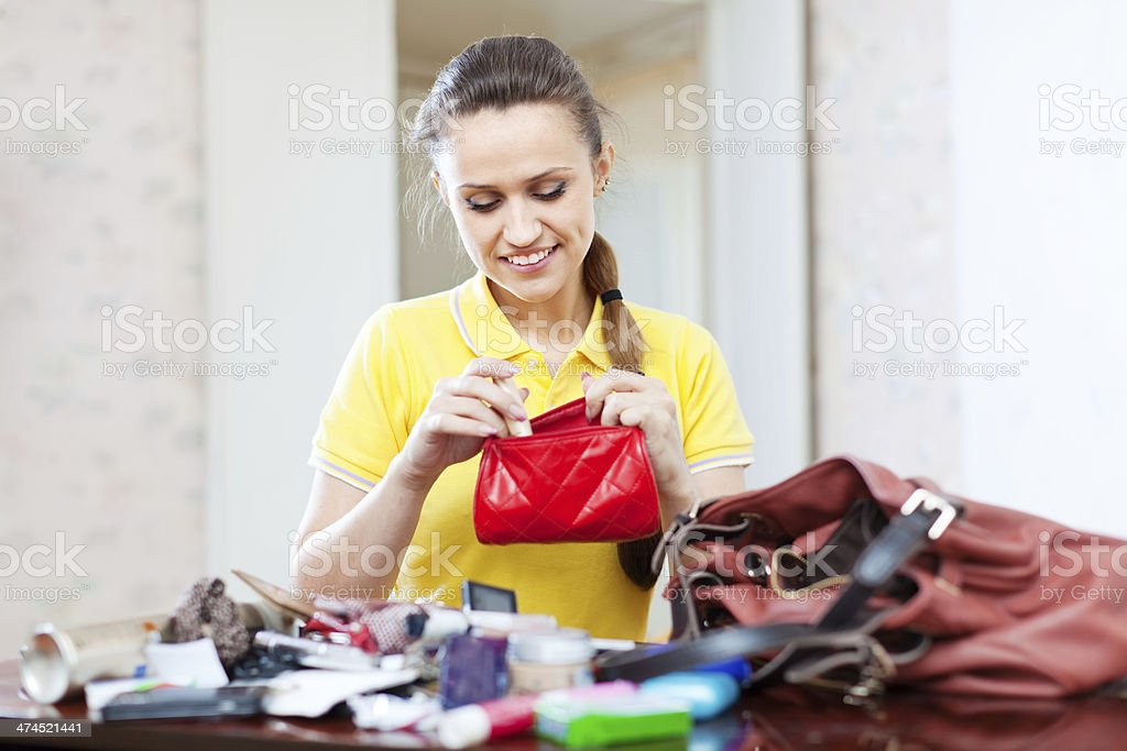 inconsiderate woman found  thing in purse stock photo