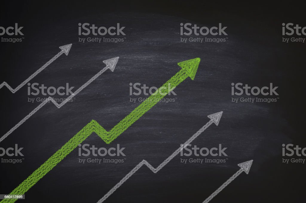 Increase in stocks on blackboard stock photo