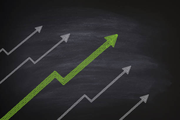 increase in stocks on blackboard - moving up stock photos and pictures