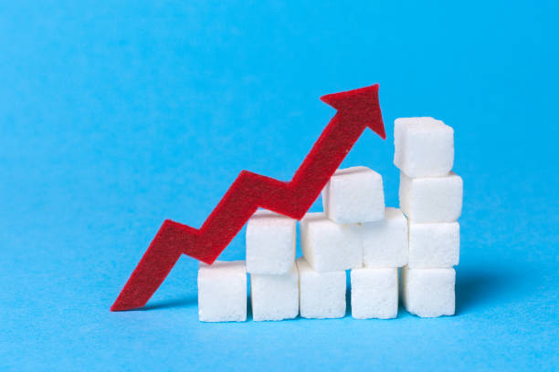 Increase the sugar content in the cow. Diabetes. Stair of sugar cubes and a red arrow up on a blue background. Increase the sugar content in the cow. Diabetes. Stair of sugar cubes and a red arrow up on a blue background. hyperglycemia stock pictures, royalty-free photos & images