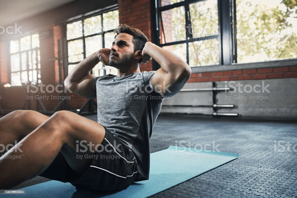Increasing back, shoulder, and arm strength stock photo