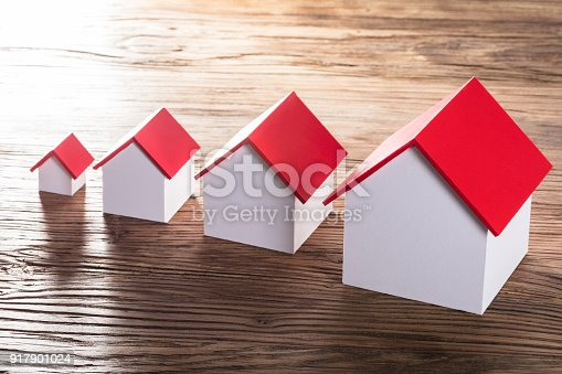 istock Increasing House Models On Table 917901024