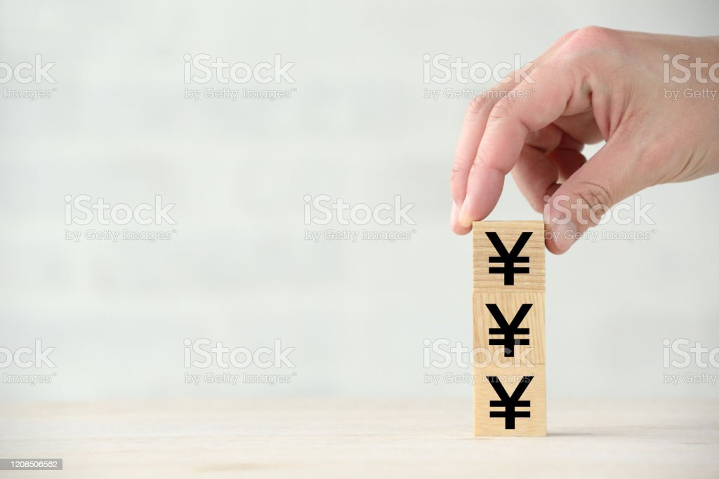 Increasing Japanese yen images with wooden blocks Increasing Japanese yen images with wooden blocks Adult Stock Photo